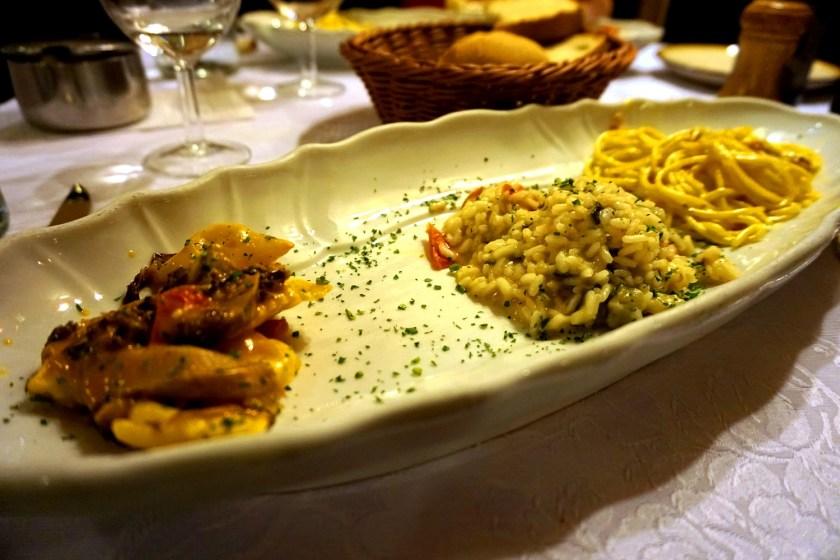 Proeverij van ravioli, risotto en spaghetti