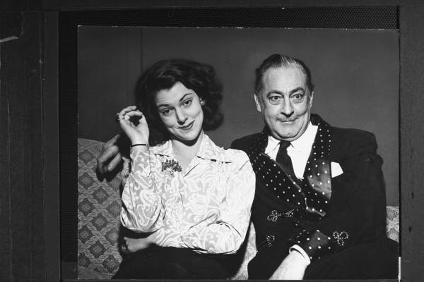 """February 15, 1942Actor John Barrymore w. his daughter Diana demonstrating """"happiness"""" emotion for story on his coaching her acting for her first movie role in """"Eagle Squadron,"""" on John's 60th birthday."""