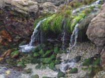 A waterfall on the beach