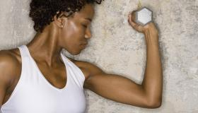 Woman exercising with dumbbell