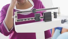 African American woman weighing herself