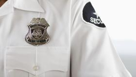 Security guard wearing badge