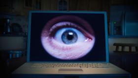 Man's eye on lap top computer
