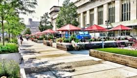Sidewalk Cafe By Buildings In City
