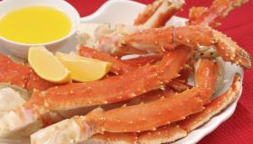 Crab legs served with lemon and butter