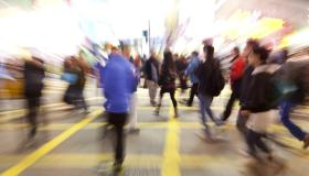 Young people crossing street, motion blur