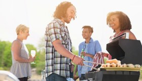 Friends talking at barbecue