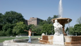 A girl walking on the classical fountain near Museum of Art.