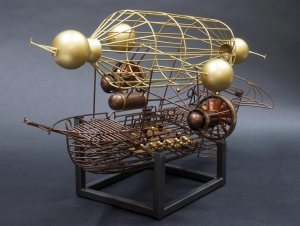 "the metal sculpture ""Aerial"" by Lon Walters at Rong Wranch art. A metal work depiction of a wire frame galleon shaped dirigible"