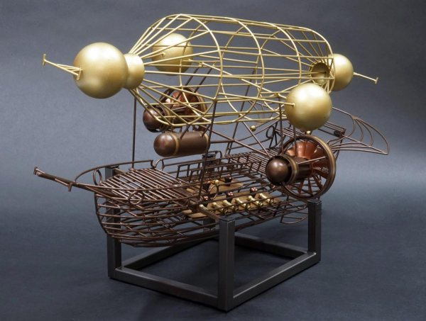 """the metal sculpture """"Aerial"""" by Lon Walters at Rong Wranch art. A metal work depiction of a wire frame galleon shaped dirigible"""