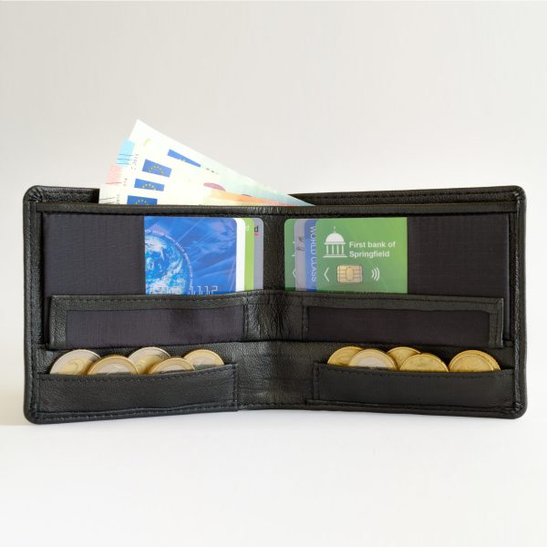 Leather version of the RONKER Wallet, open, filled with bills, cards and coins