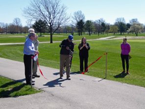 Golf Course Superintendent, Chase Walden, cutting the ribbon