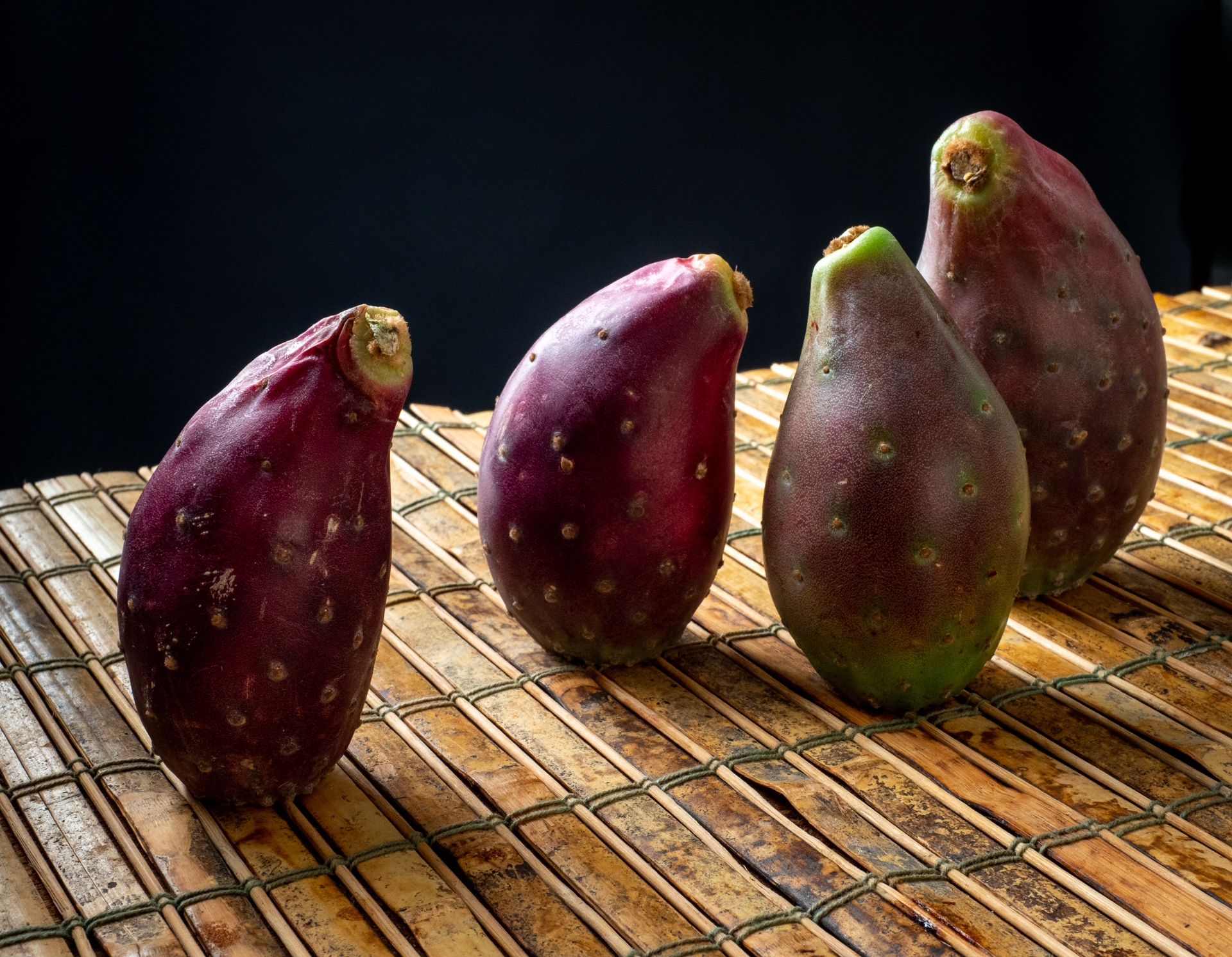 Four Prickly Pears on a bamboo mat