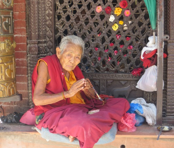 Buddhist Monk or beggar. It is getting hard to tell.