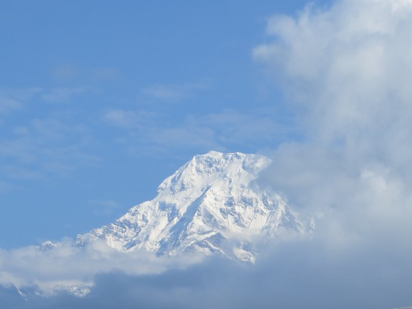 Annapurna South peeks out at us as we drive to our departure point
