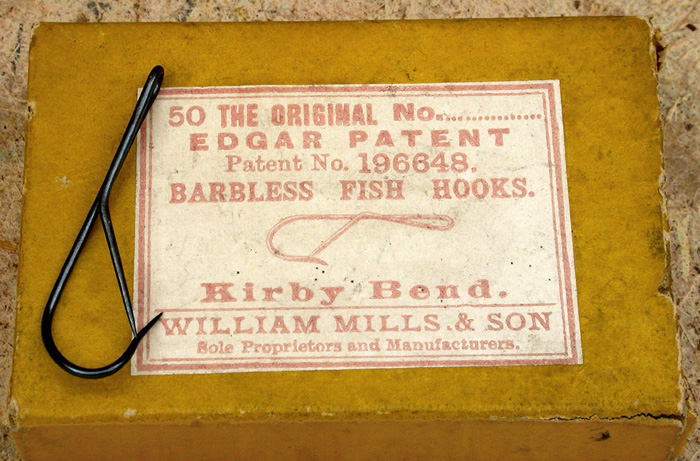 "13. Edgar Patent Barbless Hooks, #?, kirby bend, blued, patent No. 196648, made by William Mills & Son, sole proprietors and manufacturers. About 1 ½"" long."