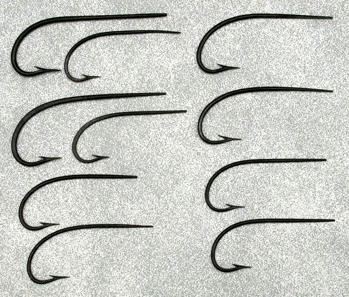 Unknown blind eye Salmon hooks. Shows three close up shots of three of the points/barbs. These were salvaged from vintage flies. Gift from Bruno Pimpanini.