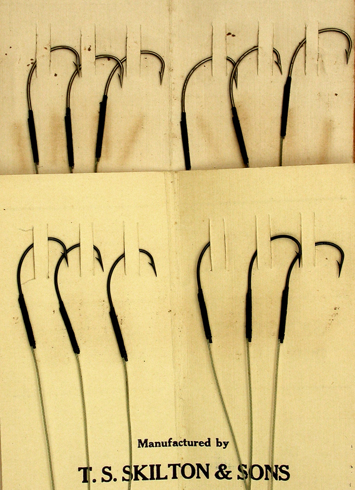 31b  Skilton & Sons snelled hook packets, Kinsey, #12 (about a 4/0), bronzed & japanned, treble gut (tight twist).