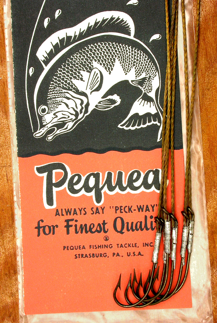 32b  Pequea snelled hooks, #21 (1/0), Pennell, Cincinnati bass, Cable wire snells, bronzed.