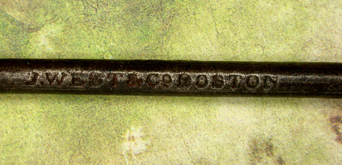 "35b  J. West & Co., Boston hooks. Other than the name Boston, there is no other name of a place of manufacture. Hook is about 4"" long and a gape of about 1 ¼"" directly above the point."