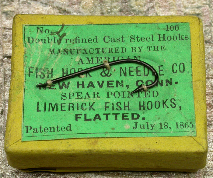 "6a American Fish Hook & Needle Co., #4, limerick, flatted, japanned. About 15/16"" long. Here you see the American Fish Hook & Needle Co. box in detail. Not only are the boxes different but as you can see by the two hooks from that box are not the same. Actually, as far as fish hooks are concerned, not even close to the same yet there are more in that box and I am certain that these hooks have remained undisturbed since they were made all those years ago. Why I love old hooks!"