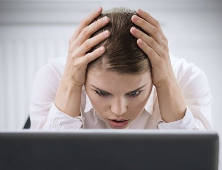 Young Woman With Computer Worried