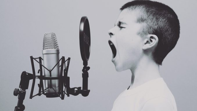 Child screaming to microphone