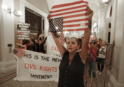 Six women had already been arrested, including two nursing mothers and a grandmother, and the Assembly gallery was filled with protesters, waiting quietly.