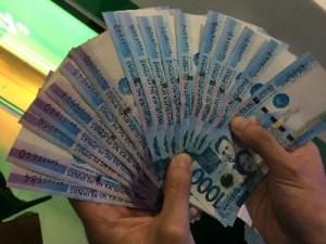 Thousand peso bills on hand