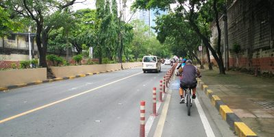 man biking along Julia Vargas bike lane