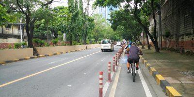 man biking along Julia Vargas bike lane