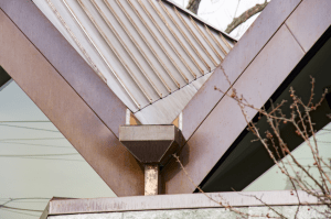 Custom five-sided downspouts were fabricated