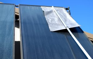 Solar panels being cleared off by a Roof Razor