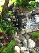 30 fantastic garden waterfall for small garden ideas (27)