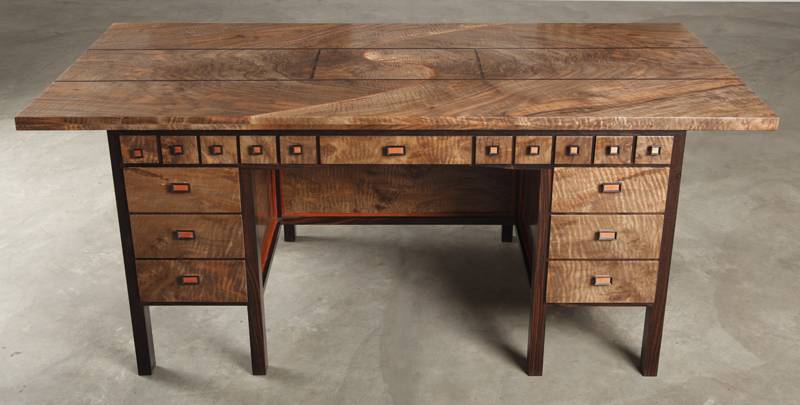 Beautiful wooden desk with many drawers.