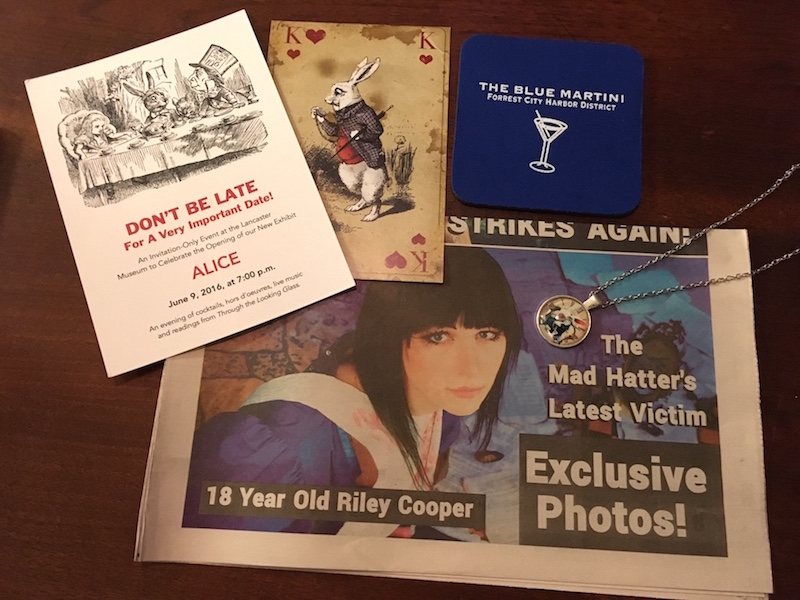 Objects from the game. A drink coaster, a pocketwatch, an invite to a party, and a newspaper featuring one of the murder victims.