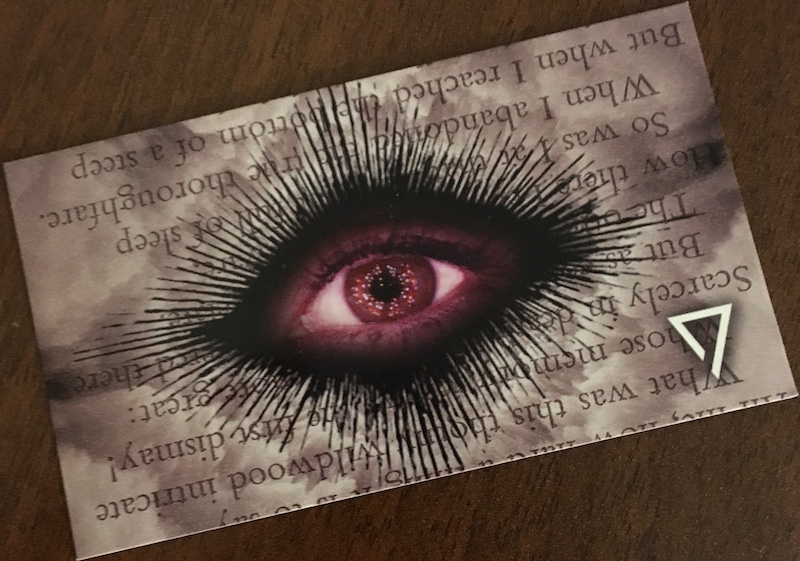 A mysterious card with an elaborate eye design on it.