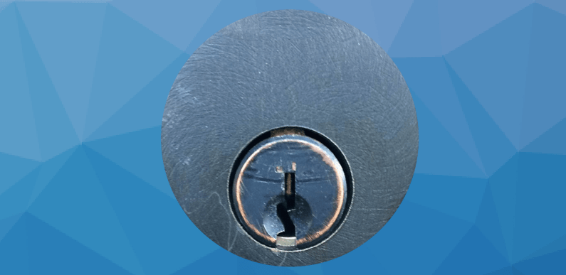 Lock keyway set against a blue geometric background.