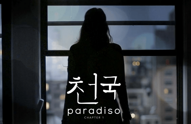 "Game promo image of a silhouetted woman looking out a city window. The name ""Paradiso: Chapter 1"" appears along the bottom."