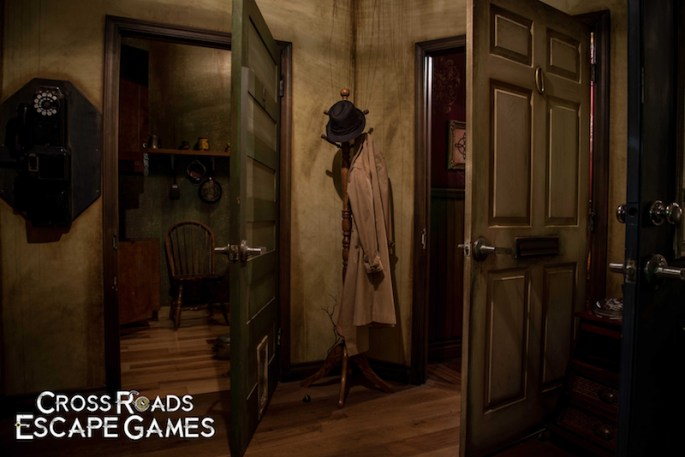 In-game, a hallway with a coatrack holding a fedora, and trenchcoat. Clearly the detective's room.