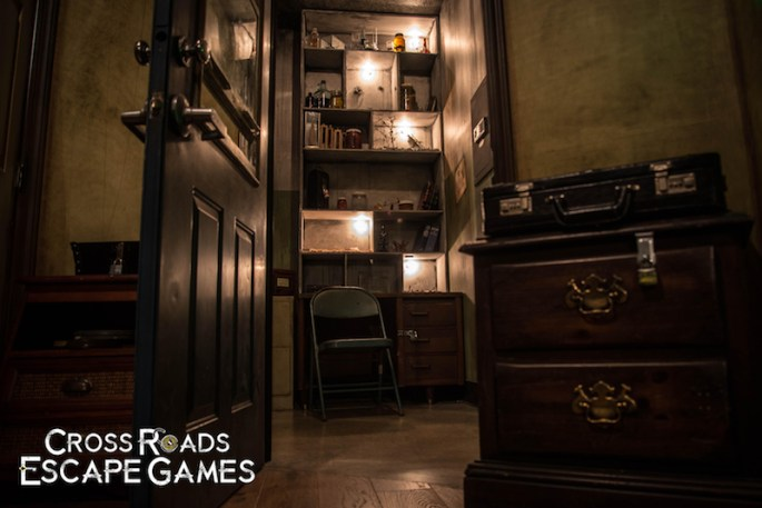 In-game image of an open door looking into a room filled with trinkets.