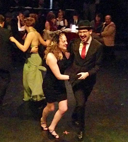 Lisa and David in costume swing dancing.