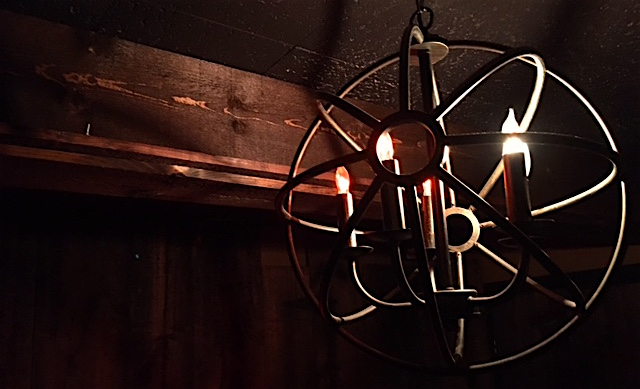 In-game: A spherical chandelier with candle-like light bulbs.