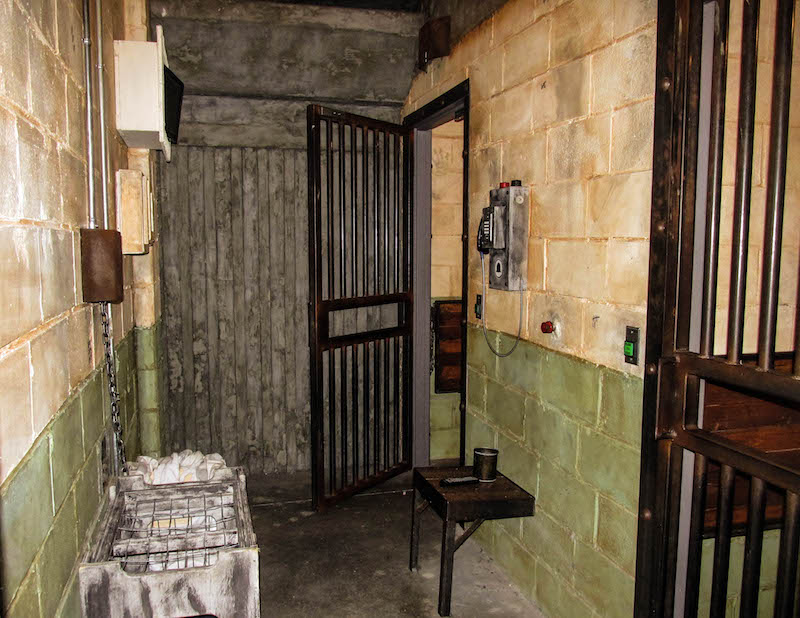 In-game: A hallway in a prison. It looks intense and heavily weathered.
