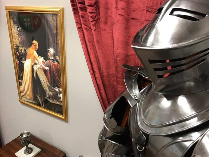 In-game: A suite of armor a grail, and a medieval painting.