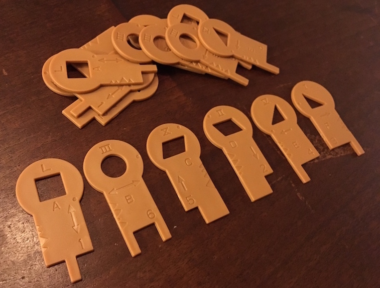 The assortment of the 6 different Chrono Decoder keys and a pile of extras in the background.