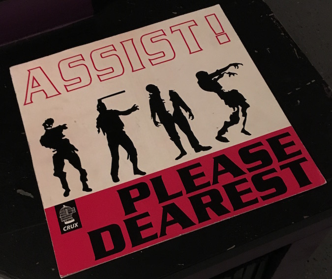 "In-game: Album art shows 4 zombies and read's ""Assist! Please Dearest"""