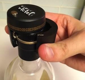 GOCHANGE Black Plastic Wine and Liquor Bottle Locks failing to close over an average bottle of gin.
