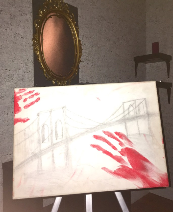 In-game; A sketch on an easel with bloody hand prints on it.