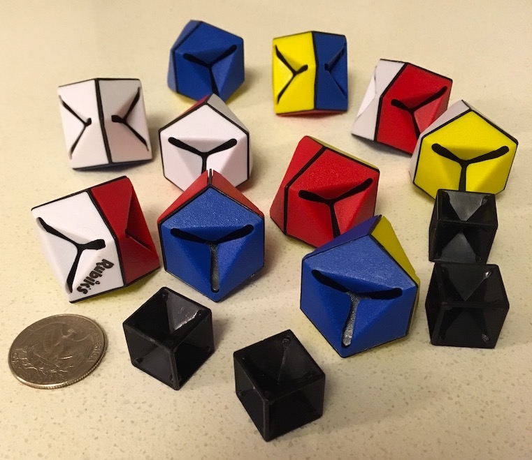 Rubik's Triamid disassembled into it's 14 pieces.